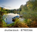 Stock photo boats on lake autumn view of the park 87985366