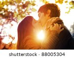 Couple Kissing In The Park At...