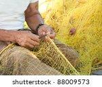 A Fisherman Mending His Yellow...