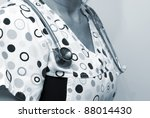 A closeup shot of a healthcare professional and her stethoscope tinted in blue. - stock photo