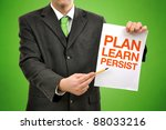 Plan, learn,persist concept, businessman holding paper with printed marketing terminology. - stock photo