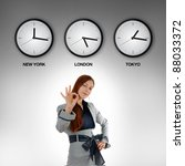 Business woman with clocks showing time in different time zones. - stock photo