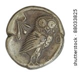 Antique  silver Greek coin from Athens circa 566 BC depicting an owl image with clipping path. - stock photo