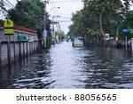 BANGKOK, THAILAND - NOVEMBER 04 : Heavy flooding from monsoon rain in Ayutthaya and north Thailand arriving in Bangkok on November 04,2011 Bangkok, Thailand.At Senanikom 2 Paholyothin Rd. - stock photo