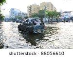 BANGKOK, THAILAND - NOVEMBER 04 : Heavy flooding from monsoon rain in Ayutthaya and north Thailand arriving in Bangkok on November 04,2011 Bangkok, Thailand.At Paholyothin Rd. - stock photo