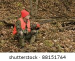 hunter sitting in the autumn woods waiting for game - stock photo