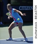 NEW YORK - AUGUST 29: Patricia Mayr-Achleitner of Austria returns ball during 1st round match against Monica Niculescu of Romania at USTA Billie Jean King National Tennis Center on Aug 29, 2011 in NYC - stock photo
