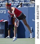 NEW YORK - AUGUST 29: Petra Kvitova of Czech Republic returns ball during 1st round match against Alexandra Dulgheru of Romania at USTA Billie Jean King National Tennis Center on August 29 2011 in NYC - stock photo