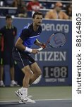 NEW YORK - AUGUST 29: Grigor Dimitrov of Bulgaria returns ball during 1st round match against Gael Monfils of France at USTA Billie Jean King National Tennis Center on August 29, 2011 in NYC - stock photo