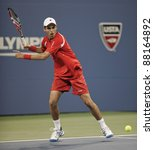 NEW YORK - AUGUST 29: Santiago Giraldo of Columbia returns ball during 1st round match against Roger Federer of Switzerland at USTA Billie Jean King National Tennis Center on August 29, 2011 in NYC - stock photo