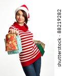 smiling christmas girl holding...   Shutterstock . vector #88219282
