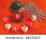 Red lantern with candles on a red background - stock photo