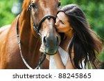 woman long hair kissing beautiful horse - stock photo