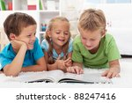 three kids having fun reading a ... | Shutterstock . vector #88247416