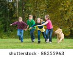 A Group Of 4 Kids Racing In A...