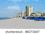 The Shoreline Of A Beach At...