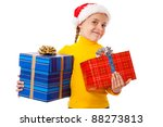 Smiling little girl in Santa's hat with two gift boxes, isolated on white - stock photo
