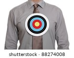businessman with a target symbol on his chest concept for sales target or targeting a person - stock photo