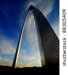 St. Louis Arch at sunset with sky and clouds in background - stock photo