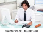 man working at his desk | Shutterstock . vector #88309330