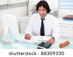 man working at his desk | Shutterstock . vector #88309330
