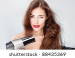Woman With Long Hair Holding...