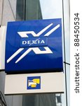 Small photo of BRUSSELS, BELGIUM – CIRCA 2009: Logo of Dexia Bank in the Wetstraat in Brussels. This bank was saved in October 2011 by the Belgian government, one of the most notable events in the Euro debt crisis.