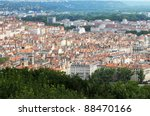 View on the tenement houses roofs and chimneys in Lyon, France - stock photo
