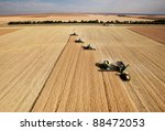 Four Harvesters Combing On A...