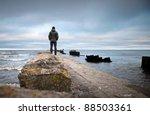 A Man On The Old Broken Pier...