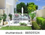Stylish outdoor patio overlooking a swimming pool and golf course - stock photo