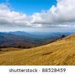 view on mountain valley in autumn time - stock photo