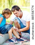 dad helping boy to wipe blood... | Shutterstock . vector #88558774