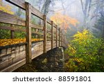 Autumn Appalachian Hiking Trail Foggy Nature Blue Ridge Fall Foliage Bridge near Grandfather Mountain - stock photo