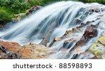 Cascading waterfall in the San Juan Mountains, Colorado. - stock photo