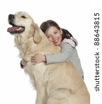 Stock photo a cute young girl holding a golden retriever puppy 88643815
