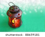 Christmas background with a beautiful red lantern on a green background - stock photo