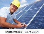 man installing solar panels | Shutterstock . vector #88752814