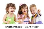 happy children group with ice cream in studio isolated - stock photo