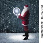 Santa Claus Holding Glowing...