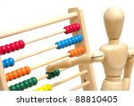 A mannequin positions a few beads on the abacus to solve his math. - stock photo
