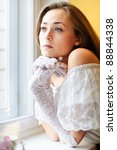 young beautiful woman near the...   Shutterstock . vector #88844338