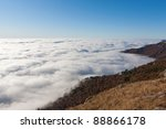Over clouds in mountain in morning time - stock photo