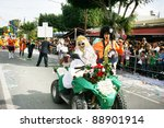 LIMASSOL,CYPRUS-MARCH 6, 2011: Unidentified people on motorbike in carnival parade. - stock photo