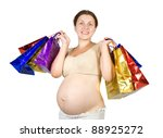 pregnant woman with shopping bags. Isolated with clipping path - stock photo