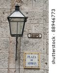 Plaza de Armas street sign and lantern in Havana - stock photo