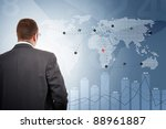 Manager controlling flights of aeroplanes around the world - stock photo
