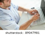 young businessman typing on... | Shutterstock . vector #89047981