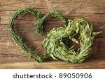 Two Green Hearts On Wooden...