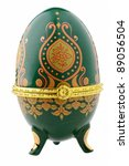 Small photo of Decorative ceramic easter egg for jewellery (Faberge egg) against white background.